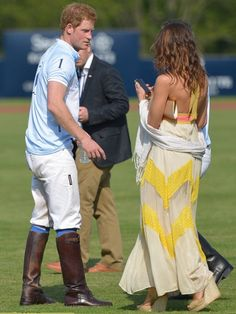 4542f0c8829f Prince Harry relaxes with a female bystander after the end of the polo match  Prince Henry