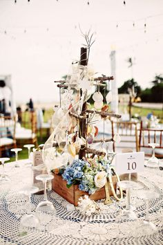 Nautical themed table centerpieces with wood boxes, flowers and seashells | Alvin and Cindy's Nautical Beach Wedding in Bali