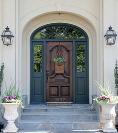 Wood stained front door with deep teal surround trim - sidelights. LLH Designs. Linsey Lewis Hasenbank