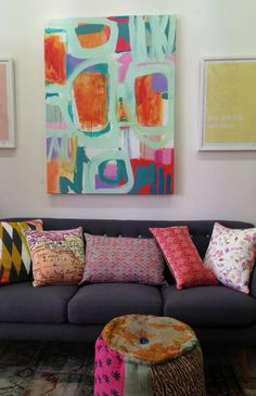 Freshly squeezed artowrk by Kezz Brett with our charcoal 3 seate4r couch.