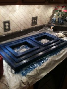 Picture frame I built using wood from a kitchen cabinet revamp!  Free wood + Lots of pretty blue paint = great looking, one of a kind piece for my home : )