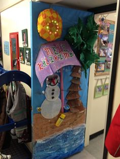 This is our version of a tropical snowman door.  We used different textures to enhance the elements.  Birdseed sand, batting snowgirl, bubble wrap water, fabric sewn sun, etc.  and tiny mini lights to accent the palm tree and sun. :)