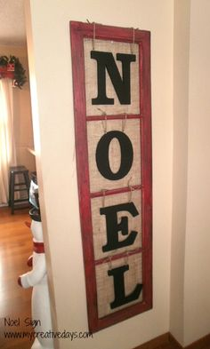 Old Window Makes Noel Sign.  You can use this year round, just buy a V and re-arrange the letters to spell LOVE & re-use at Christmas and spell NOEL