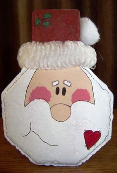 Santa Claus face door-stop or bookend, made using a concrete keyhole style paver. Can be  made with our #P-0962 Keyhole Paver Mold.