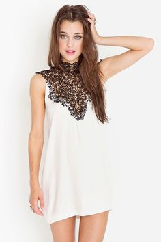 Ivory dress featuring a plunging crochet neckline and open back with tie detail. Flowy fit, unlined.