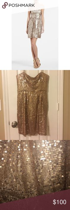 """BCBG Max Azria Carole Dress, Champagne, US 10, NWT Light up the night in this shimmering """"Carole"""" sequin cocktail dress from BCBG featured in a trendy Rose Gold color. Perfect for a special event or party, this dress features a convertible/strapless design with removable straps, non-slip banding at the top, boned support, high waisted cut, and a hem that should fall to about mid-thigh. Finished with a full lining and hidden back zip. This item is BRAND NEW with tags and removable straps…"""