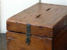 I love antique (or at least antique-looking) wooden boxes to store all kinds of stuff.