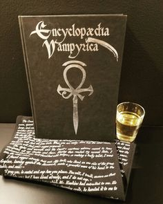 Encyclopaedia Vampyrica for Vampire the Masquerade paired with La Strega liqueur.  Dracula infinity scarf by Storiarts.