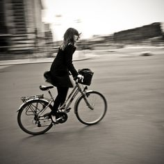 black and white girl on bicycle