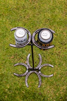 Hold your horses. Hold your drinks. This Horseshoe Drink Holderis a country-fied fancy way to display keep your drink safe while you throw the ball, catch the frisbee, flip the burger or high five your friends.