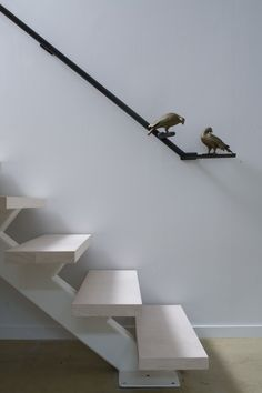 Black hand rail with birds