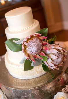 I love this ruffled bottom cake layer! Pharmacists' Peach Protea Cedarwood Wedding | Cedarwood Weddings #cedarwoodweddings