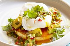 Breakfast for champions!! Bacon, avocado and poached egg with a chilli, lime and coriander dressing.