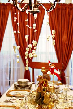 Last night I started decorating my dining room for Christmas and the Elf finished it for me with a wonderful touch of whimsy.