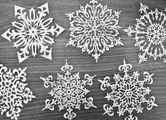 handcut paper snowflakes. i love snowflakes.
