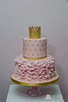 2 tier pink petal ruffle and quilted cake with delicate gold sugar bow and gold lace crown by Candytuft Cakes