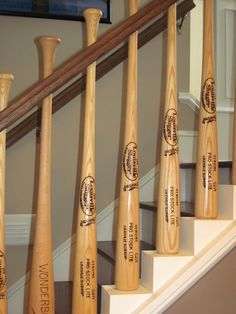 baseball bat rail....cool idea for a stairway but I'd use Yankee bats. -Ecsp. Jeter.