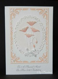 By Sandma - Prim Poppy coloured with Adirondak Mountain Rose on Spellbinders Elegant Labels Four and Decorative Oval.