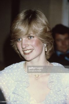 The Princess of Wales attends a charity concert at St David's Hall in Cardiff, October 1982. She wears a gown by the Emmanuels.