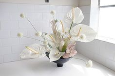 White anthurium, delicate and structural arrangements