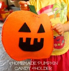 DIY Pumpkin Candy Holder from Blissfully Domestic - a super cute homemade trick-or-treat bag for your kids.