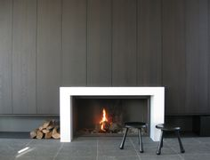 Modern fire place with flat front cabinets Ross Cassidy