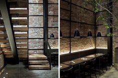 Modern French Bistro interior exposed brick