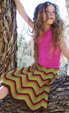 This skirt is enough reason to learn to knit...gorgeous!  (...like the model...)