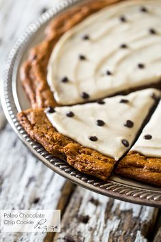 Paleo Cookie Pizza with Cashew Cream - Who needs paleo cookies when you could have a Paleo Cookie Pizza?! This chocolate chip cookie pizza is topped with cashew cream and is a gluten free dessert that is secretly healthy! | Foodfaithfitness.com | @FoodFaithFit
