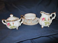 Four piece set of  cup and saucer with sugar and creamer; porcelain china rose pattern with gold accents; made in Japan; just darling!  PRICE REDUCED!