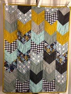 Arrow chevron quilt. Here's a link to an awesome quilt tutorial.