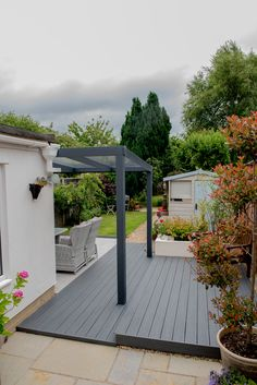 Discover our veranda range! Choose from a variety of contemporary roof styles. Request a FREE quote for your glass or polycarbonate veranda. Back Garden Design, Contemporary Garden Design, Roof Styles, Composite Decking, Back Gardens, Decking Boards, Garden Inspiration, Outdoor Spaces, Pergola