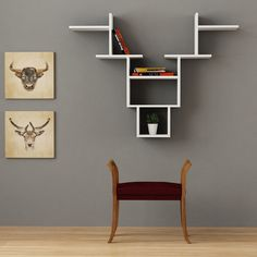 The Decortie Deer Wall Shelf is a one-of-a-kind contemporary piece that is sure to add character to your space.  Featuring plenty of nooks, crannies, and shelf-