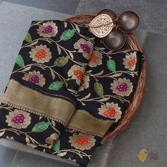 Black Pure Katan Silk Banarasi Handloom - A gorgeous black drape, with all the glamour and drama that is the hallmark of Banarasi handloom! Indulgent zari work and a delightful floral web with masterly Meenakari accents.
