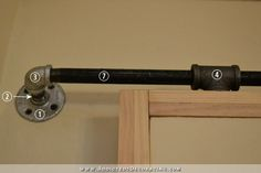 DIY rolling barn door style door hardware