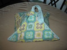 """DIY Casserole Carrier.  What I did different than the tutorial:  cut my squares to be 25"""" so they could hold a large casserole dish or 9x13 pan.  Cut my straps as follows:  (2) at 8"""" x 3"""", (1) at 23"""" x 3"""".   The 17"""" squares in the tutorial would work great for a pie pan or 8"""" square pan"""