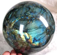 Labradorite Crystal Ball***** Highly mystical and protective stone. Bringer of Light. Raises consciousness and connects with universal energies. Can take you to another world or into other's lives. This is a stone of esoteric knowledge. Stimulates intuition and psychic gifts. Brings messages from the unconscious mind to the surface and gives understanding of them.
