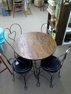 """$175 - This is a child's size soda fountain style wood top table with metal base and 4 metal chairs. A fresh coat of black paint on all metal surfaces. Table measures approximately 23 1/2"""" diameter and stands 22 1/2"""" tall. It can be seen in booth F1 at Main Street Antique Mall 7260 East Main Street ( E of Power Rd ) Mesa, AZ 85207 480 9241122open 7 days a week 10a.m to 5 : 30p.m Cash, charge or 30 day layaway accepted"""