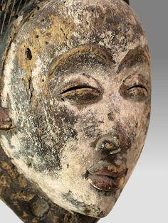 "Punu Duma or Mvudi mask, Gabon wood, pigment, kaolin 10.5"" tall x 7"" wide early 20th century"