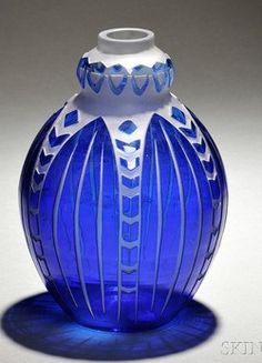 A Charles Catteau Art Deco art glass vase, probably produced by Scailmont, Belgium, blue overlay acid-etched repeating stylized leaf and chevron pattern;