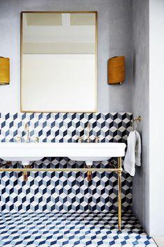 Tiled bathroom with open vanity