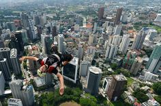 Base jump in the city (Photo: Mohd Rasfan / AFP - Getty Images)