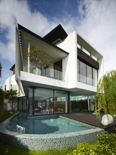 Cove Grove Sentosa | Aamer Architects Curved pool wall with fully tiled glass mosaic facade. Pinned to Pool Design by Darin Bradbury.