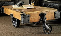 """""""Add some history to your home with this distinctive cocktail table modeled after classic American wagon carts. Handcrafted and hand-finished, the reclaimed pine and aged iron accents may crack or rust over time, which undeniably adds character and..."""""""