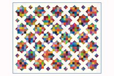 Grab your leftover fabrics and use this easy colorful scrap quilt pattern to create a quilt that's uniquely yours. Piecing options make the quilt a breeze.