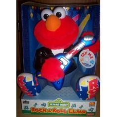 He used to dance when Elmo started going off:) Sesame Street Toys, Elmo, Playing Guitar, Fisher Price, Rock N Roll, Dinosaur Stuffed Animal, Singing, Rolls, Plush