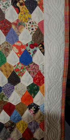 susis quilts: modified kite shapes, or you could say modified hexagons as there are six sides to each block.