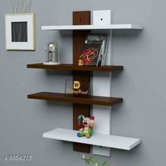 Shelves Beautiful Decorative Wall Shelves Material: Wooden Size: (H X W) - 25 in X 5 in  Description: It Has 1 Pack Of Wall Shelves Country of Origin: India Sizes Available: Free Size   Catalog Rating: ★4 (1559)  Catalog Name: Elite Beautiful Decorative Wall Shelves Vol 3 CatalogID_900774 C127-SC1622 Code: 346-5954273-