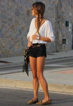 Black shorts, loose white flowing top, brown belt