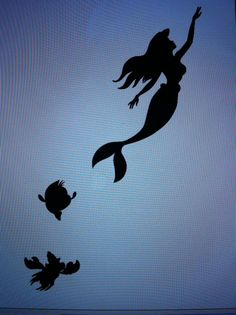The Little Mermaid silhouette as a tattoo behind my ear!! Tribute to classic Disney haha someone has a tatto of me and brian and emily.